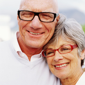 Senior couple wearing spectacles, smiling, portrait